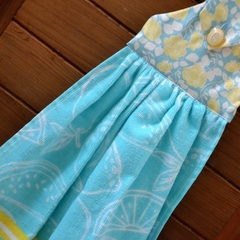 Fabric topped aqua and yellow hanging hand towel