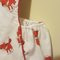 Ridiculously cute foxy romper with red piping.
