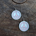 Groovy wooden peace sign earrings in pink and blue