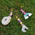 Bubble gum style wooden pastel coloured rollerskate keyring