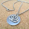 Silver Lotus and Stainless Steel Disc Necklace