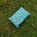Tissue holder flowers on teal quilting cotton fabric