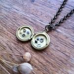 Tiny little watch part locket pendant! Clockwork jewellery!