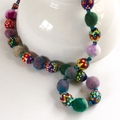 Unique felt and hand painted bead necklace.  Multiple colours. One of a kind.