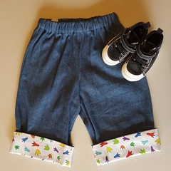Little Hipster Pants with cuff. Cuff in white with dino foot prints. Size 1