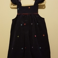 Overall dress in embroidered navy blue corduroy. Size 2