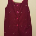 Pinaform dress in burgundy corduroy with embroidered flowers