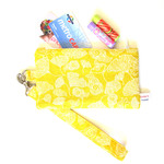 Wristlet, pouch in yellow floral cotton fabric.