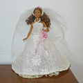Doll and bridal clothes. 5 piece set. Includes doll