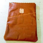 Soft upcycled leather zipped purse made from a vintage leather jacket