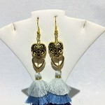 Gold earrings with triple layer blue tassels, gold hearts, gold bead frame.