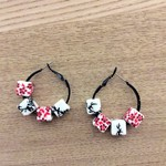 Black earrings, hoop with black, white and red square ceramic beads.