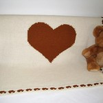 Super soft and thick (16ply) hand knitted Baby Blanket with a Golden Heart...