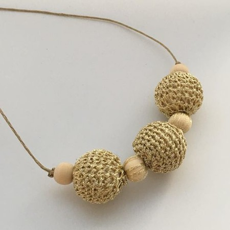 Gold and neutral beaded necklace