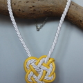 Yellow and white Celtic knot pendant