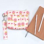Pleated clutch wristlet bag in pink and cream floral cotton fabric
