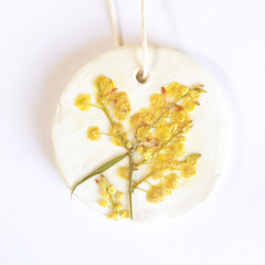 Reusable clay fragrance diffuser with pressed wattle blossom