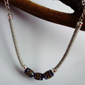 Blue glass painted beads on grey cord with silver chain