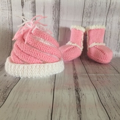 Pink and white knitted beanie and ugg booties.