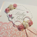 Soft Pink & White Flowers Baby Girl Card with detailed Metallic pink background