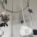 Handmade baby mobile with felt moon and crochet sheep
