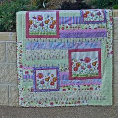 Cot quilt, floor rug, baby blanket, play rug. Pink, purple & green