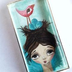 Girl, pink bird, teal eggs. Silver, glass, chain, original art pendant