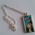 Girl and pink bird pendant. Silver, glass, chain, original art