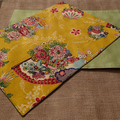 GIFT SETS: Placemats in Kimono Fan Mustard with Dinner Napkins in Black.