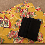 GIFT SET: 4 Placemats in Kimono Fan Mustard with 4 Dinner Napkins in Black.