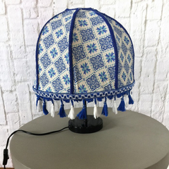 Blue and white lampshade with blue and white lace fringe tassel braid.