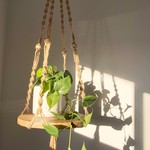 Plant hanger, macrame, jute with Acacia wood and beads.