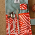 Hand made cutlery roll.  Orange.
