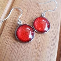 Red shimmer earrings