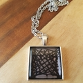 Abstract silver and black pendant