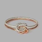 Rose gold and twisted silver double love knot ring