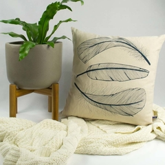 Cushion cover with Three Feather print in navy. 50cm square.