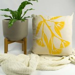 Cushion cover with Gum Blossom print in yellow. 50cm square.