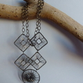 Wire and metal necklace on gun metal chain