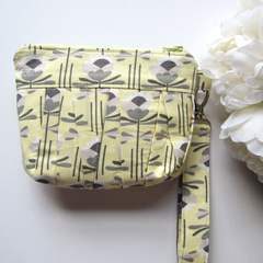 Wristlet clutch makeup bag in yellow and grey pleated fabric