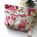 Wristlet clutch bag in pink magnolias