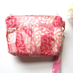 Wristlet clutch and makeup bag in pink pleated floral fabric