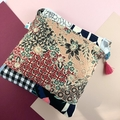 Cosmetics / makeup bag with flower brooch and beaded tassel- patchwork pinks