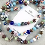 Handcrafted polymer clay and crystal long necklace