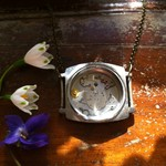 Inspiration - OOAK watch casing necklace. Standout necklace full of watch parts.