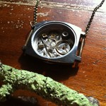 Happiness - one of a kind watch casing necklace, filled with watch parts.