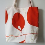 Small lined tote bag in orange floral print made with cotton fabric