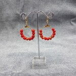 Hoop earrings, red and gold beads.