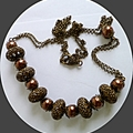 Long rustic bronze pearl, metal pod necklace.
