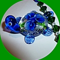 A gorgeous blue and green glass turtle on a handmade chain